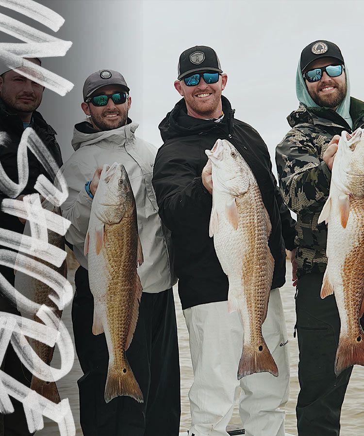 4 men holding fish