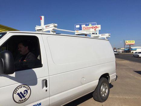 Van with ladder rack