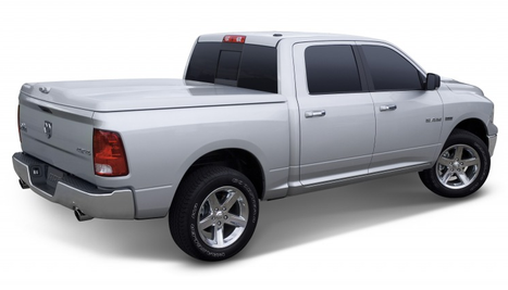 Silver truck with bed cover