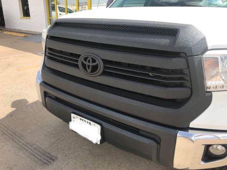 Spray liner on truck grill