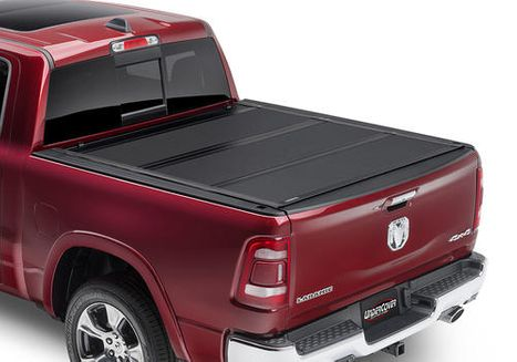 Red truck with bed cover