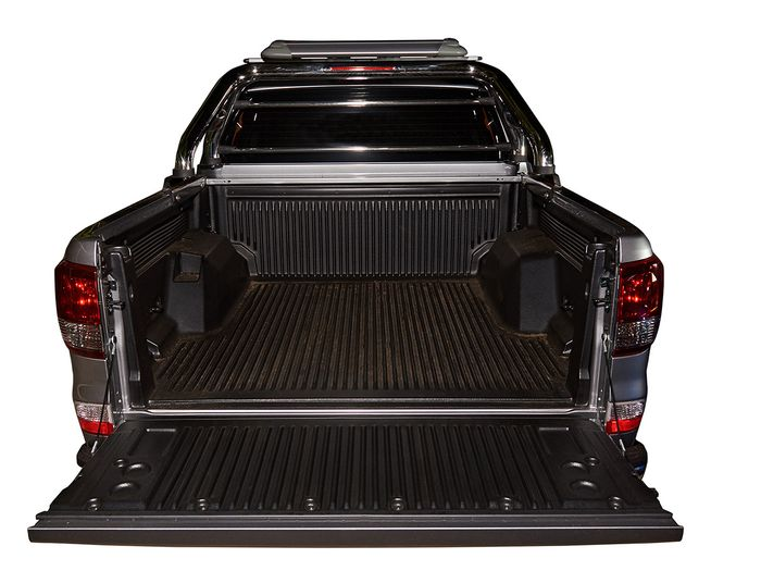 Bed of pickup truck with open tailgate
