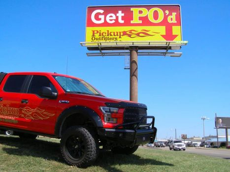 Truck with topper on the bed