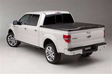 White truck with bed cover