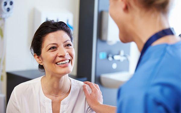 woman talking to nurse about botox