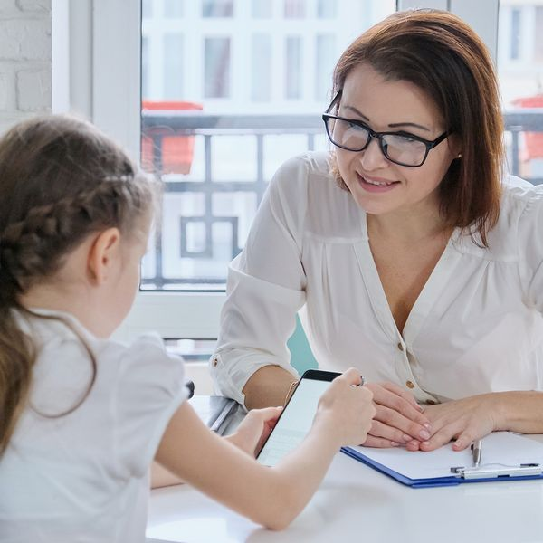 Female counselor speaking with young girl