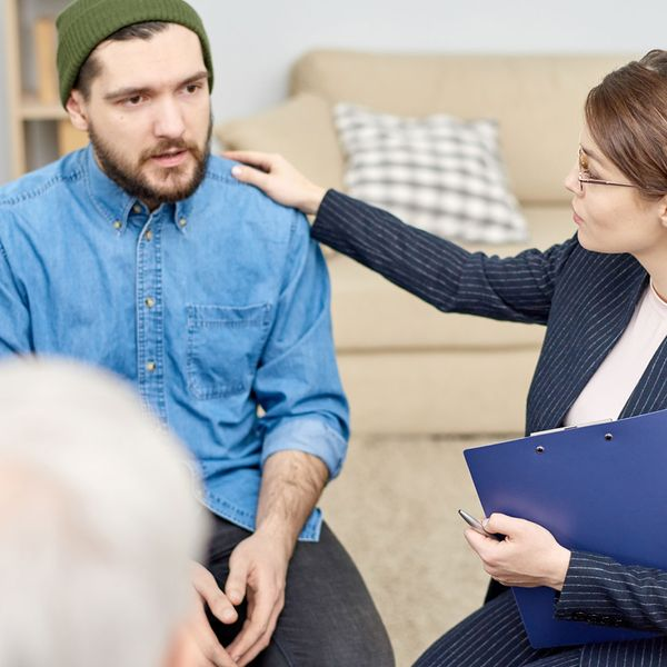 Licensed counselor helping comfort during group therapy session