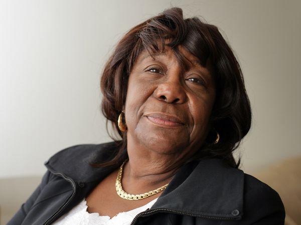 Elderly African American woman looking at camera