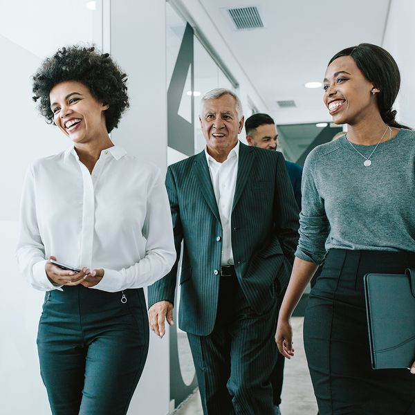 Team of counselors walking in office