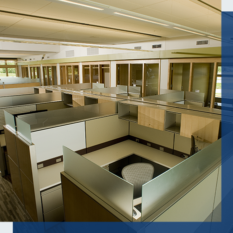 Image of a large office area with empty cubicles.
