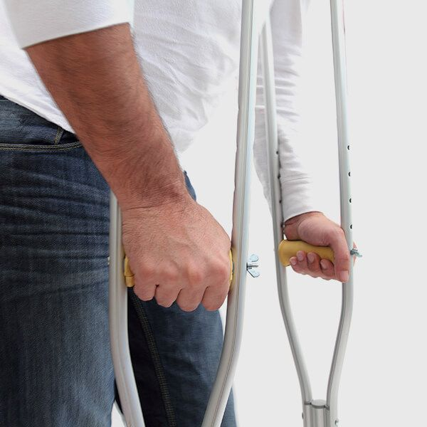 Image of man with crutches