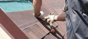 Man replacing roofing tile