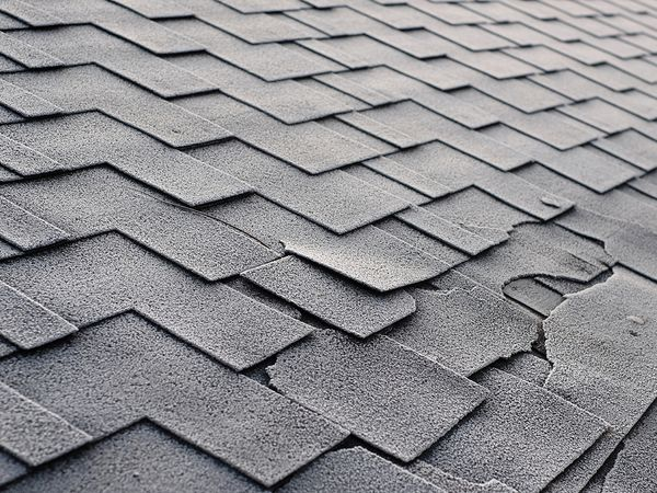 An image of a roof with broken shingles.