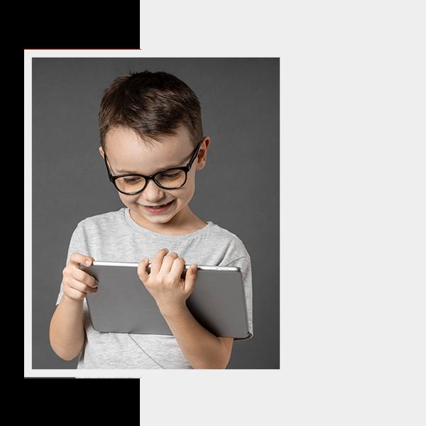 image of a kid using an ipad