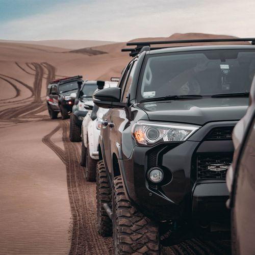 row of offroad tucks in desert