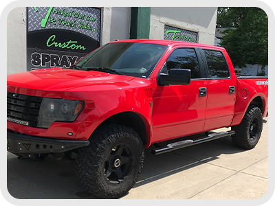 red truck with tinted windows