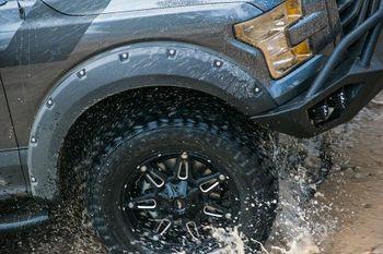 Truck driving through mud