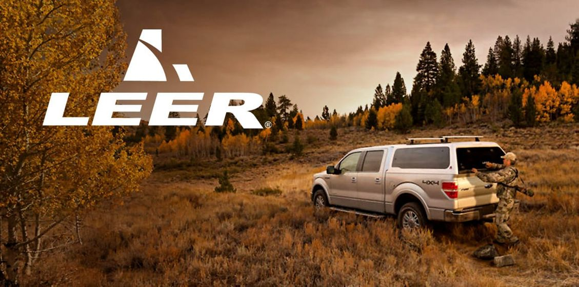 leer topper on silver truck in autumn