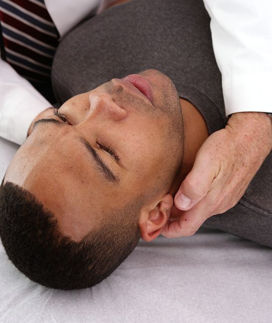 african american male seeing chiropractor for neck pain img