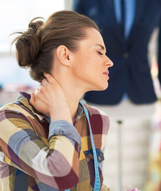 woman grabbing neck in pain img