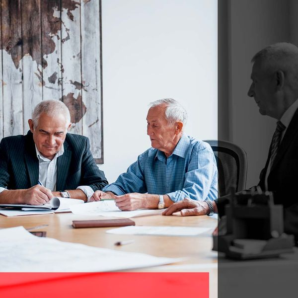 A team of senior architects in an office.