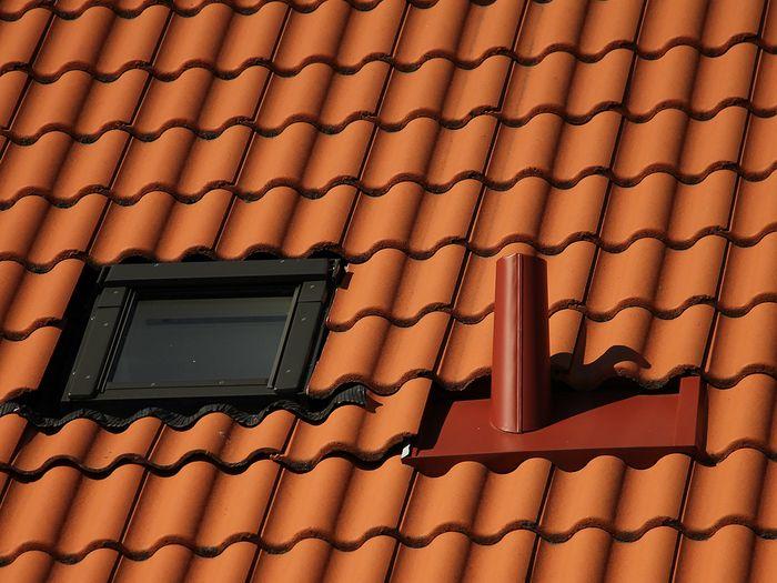 image of orange roofing shingles