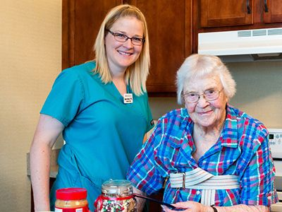Nurse and patient in kitchen performing occupational therapy