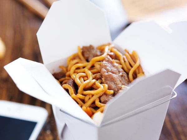 Chinese Food on Table Next to Mobile Phone