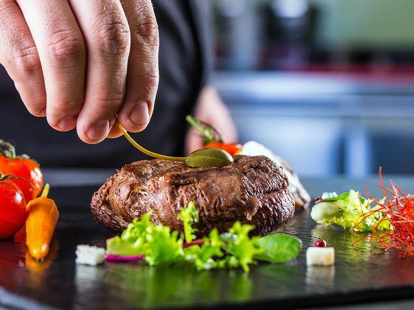 Chef Preparing Steak Meal