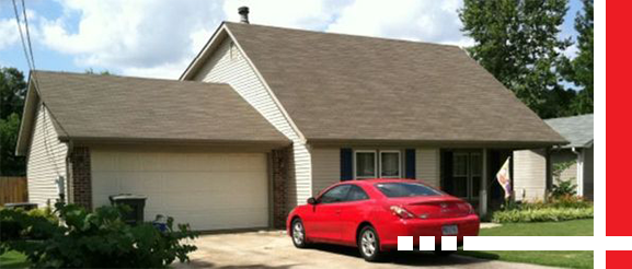 A home with new sidings and windows done by Holt's Siding & Replacement Windows.