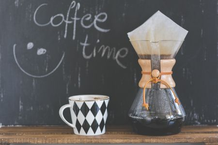 Canva - Coffee time sentence, cup of coffee and Chemex.jpg