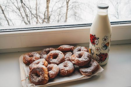 Canva - Doughnuts and Milk Bottle Near Clear Glass Window.jpg
