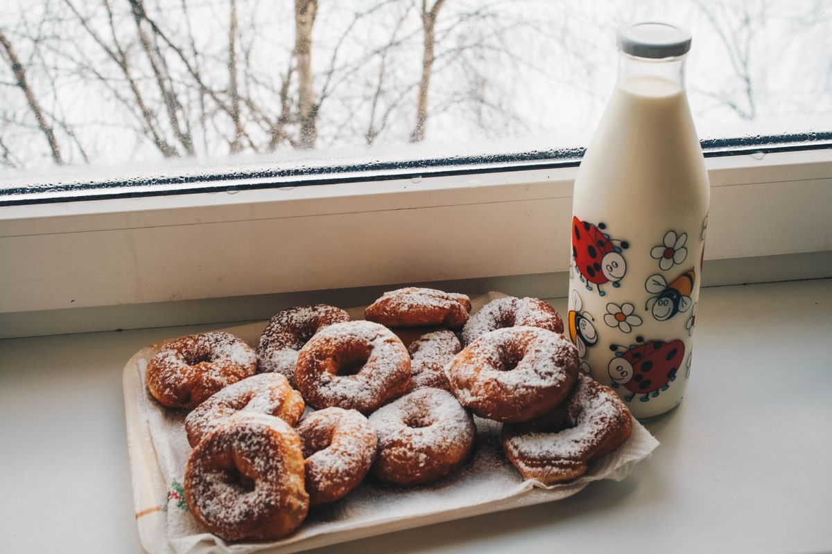 Canva - Doughnuts and Milk Bottle Near Clear Glass Window.jpg