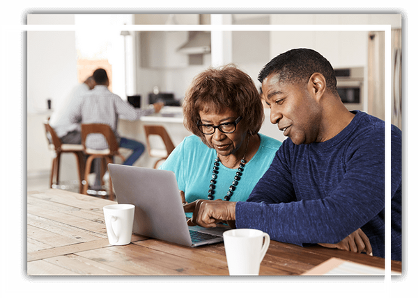 adult son and mom looking at computer