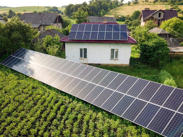 A home with solar ground mounts on the property.