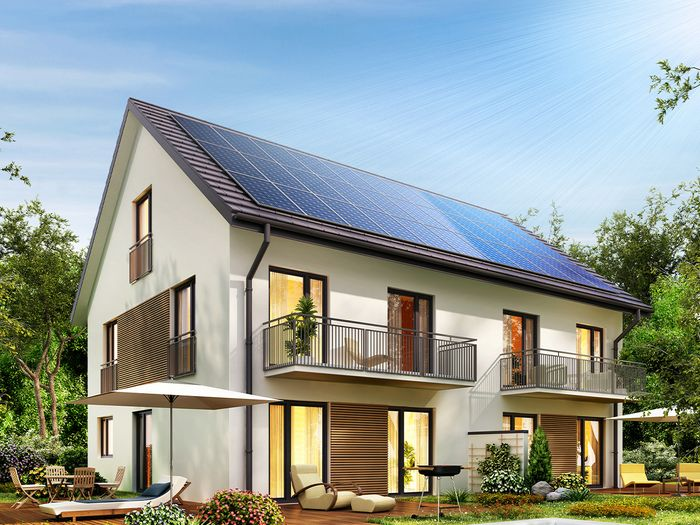 Rooftop solar panels installed on a two-story townhome.