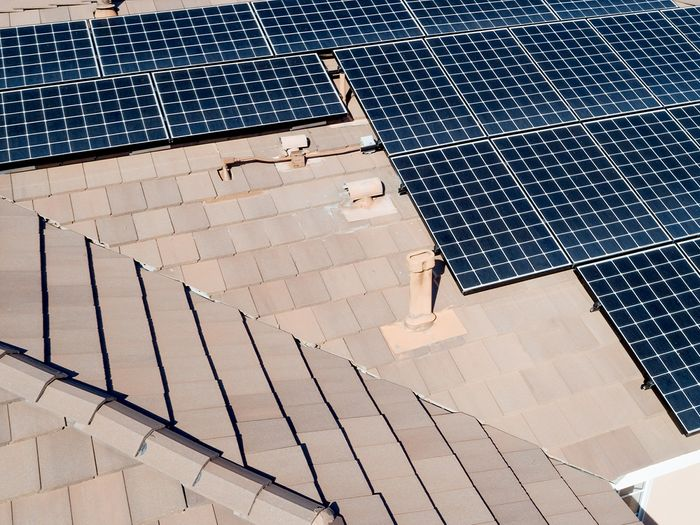 Rooftop solar panels installed on a large home.