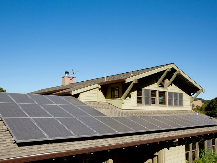 A large home with rooftop solar panels.
