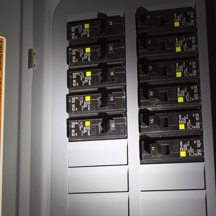 A home's electrical breaker box during a power outage.