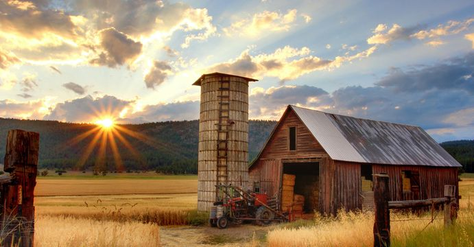 Barn with hay in it at sunset