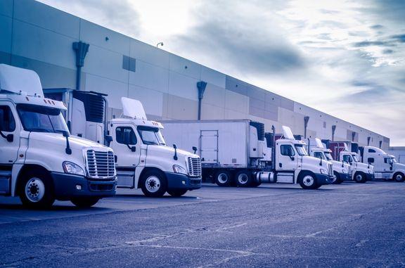 image of semi trucks in a lot