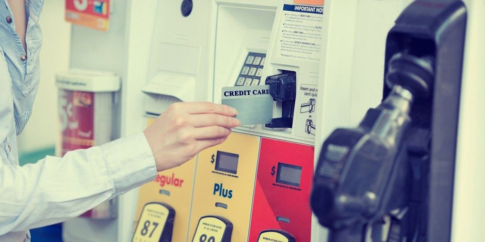 Using a credit card at a gas pump