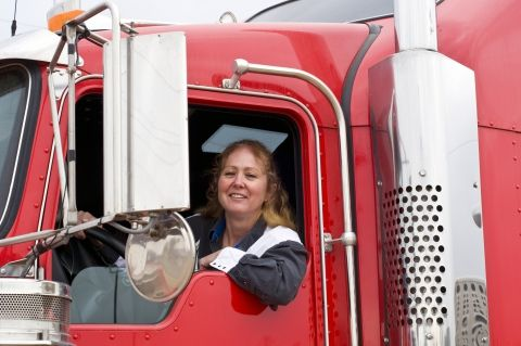 image of a woman driving a semi truck