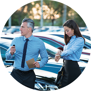 image of two people in a parking lot