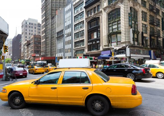 image of taxi cabs in a city