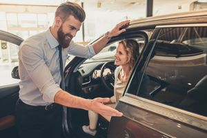 Picture of a man selling a car
