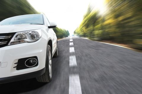image of a car driving on a road