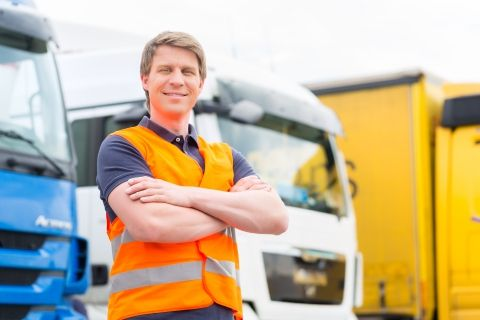 image of a man in front of a semi truck