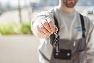 Man handing over car keys