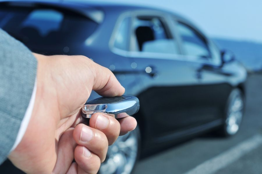 image of a man unlocking a care with a key fob